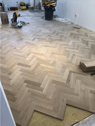 Unfinished White Oak Herringbone installation